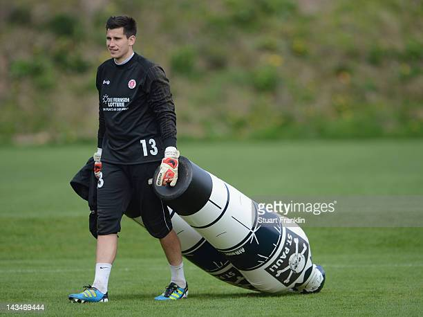 Philipp Tschauner of St Pauli carries some training dumbies during the training session of FC StPauli on April 27 2012 in Hamburg Germany