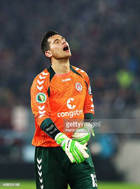 Philipp Tschauner of St Pauli dejected after the DFB Cup match between FC St Pauli and Borussia Dortmund at Millerntor Stadium on October 28 2014 in...
