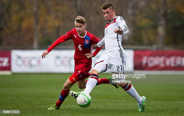 Philipp Tvaroh of Czech Republic battles for the ball with Renat Dadachov of Germany during the international friendly match between U16 Czech...