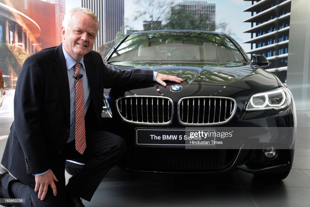 Philipp von Sahr, President, BMW Group India poses with the new 2014 BMW 5 Series facelift during its launch at sector-14 BMW Showroom on October 10, 2013 in Gurgaon, India. The new BMW 5 Series facelift has been launched with three diesel engine options and comes in three trim levels. Its starting price is INR 46.90 lakhs.