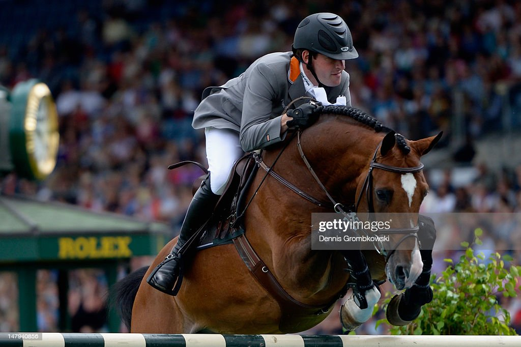 Philipp Weishaupt of Germany and his horse Catoki compete in the RWE Prize of North-Rhine-Westphalia jumping competition during day four of the 2012 CHIO Aachen tournament on July 6, 2012 in Aachen, Germany.