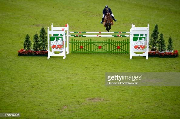 Philipp Weishaupt of Germany and Monte Bellini compete in the Warsteiner Price of Europe S4 jumping competition during day two of the 2012 CHIO...
