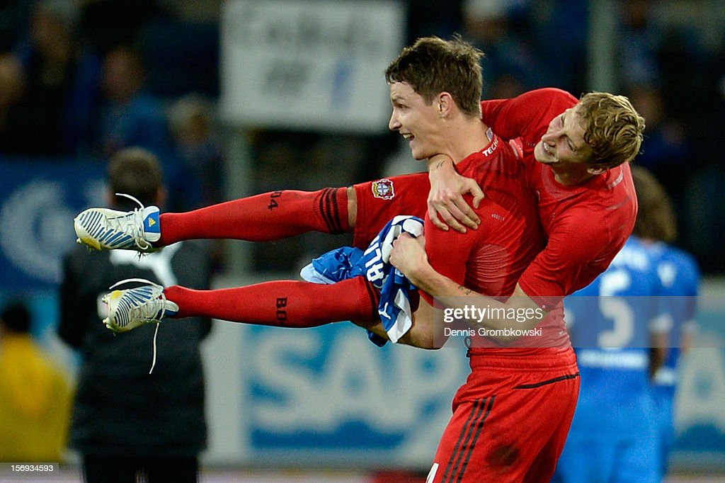 Philipp Wollscheid of Leverkusen carries Stefan Kiessling as they celebrate after the Bundesliga match between TSG 1899 Hoffenheim and Bayer 04...
