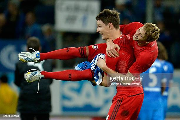 Philipp Wollscheid of Leverkusen carries Stefan Kiessling as they celebrate after the Bundesliga match between TSG 1899 Hoffenheim and Bayer 04...
