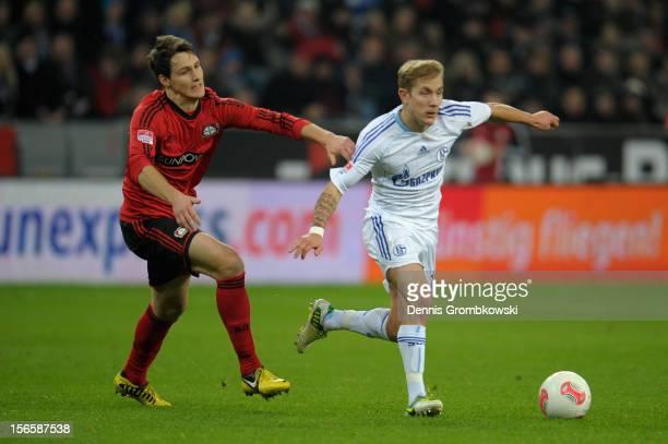 Philipp Wollscheid of Leverkusen chases Lewis Holtby of Schalke during the Bundesliga match between Bayer 04 Leverkusen and FC Schalke 04 at BayArena...