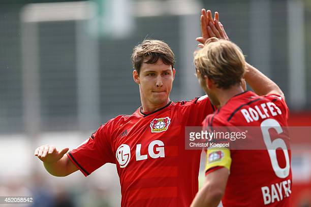 Philipp Wollscheid of Leverkusen cleebrates the first goal with Simon Rolfes during the friendly match between Bayer Leverkusen and Lierse SK at...