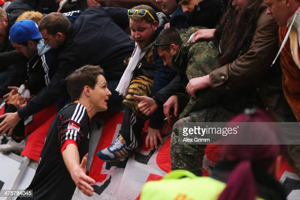Philipp Wollscheid of Leverkusen discusses with the fans after the Bundesliga match between Bayer 04 Leverkusen and 1 FSV Mainz 05 at BayArena on...