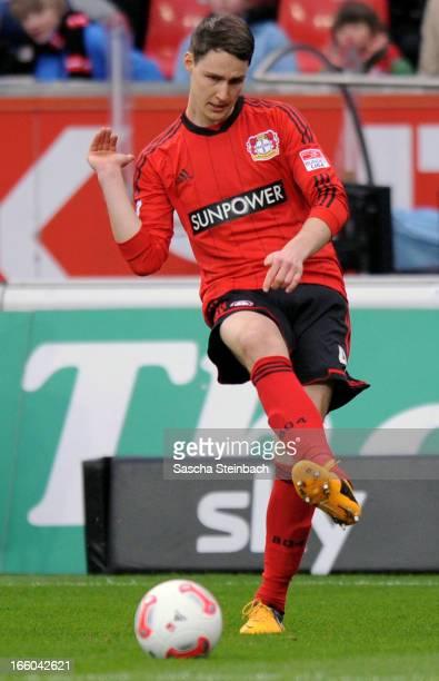 Philipp Wollscheid of Leverkusen runs with the ball during the Bundesliga match between Bayer 04 Leverkusen and VfL Wolfsburg at BayArena on April 6...