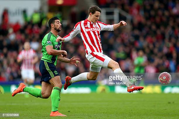 Philipp Wollscheid of Stoke City and Graziano Pelle of Southampton compete for the ball during the Barclays Premier League match between Stoke City...
