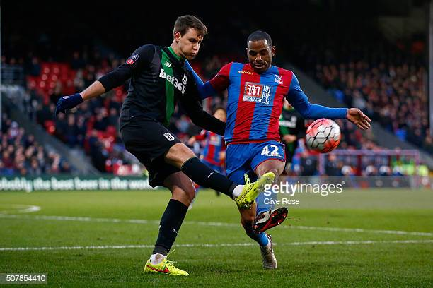 Philipp Wollscheid of Stoke City and Jason Puncheon of Crystal Palace compete for the ball during The Emirates FA Cup fourth round match between...
