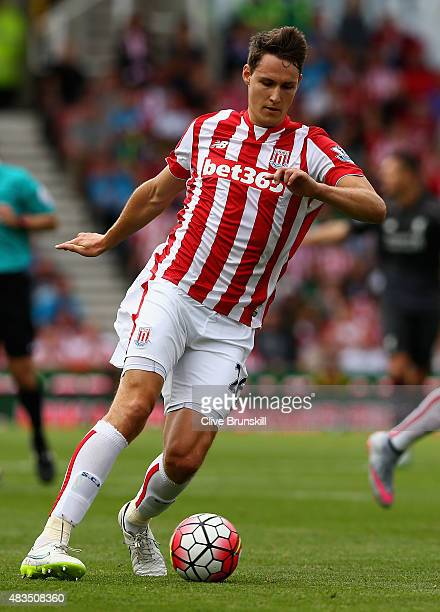 Philipp Wollscheid of Stoke City in action during the Barclays Premier League match between Stoke City and Liverpool at Britannia Stadium on August 9...