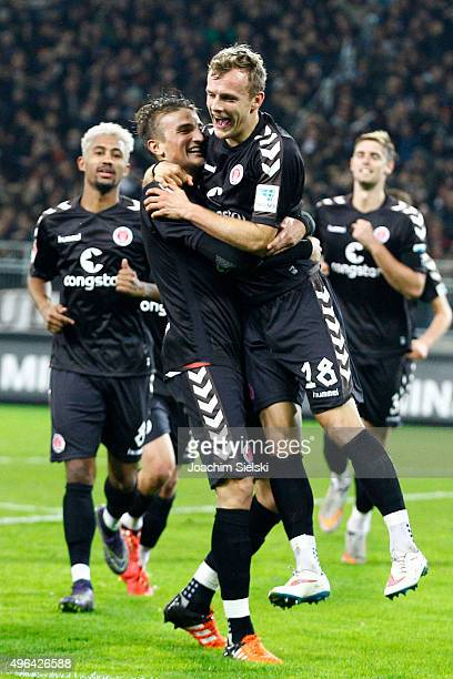 Philipp Ziereis and Goalgetter Lennart Thy of St Pauli celebrate the Goal 30 for St Pauli during the Second Bundesliga match between FC St Pauli and...