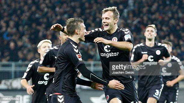 Philipp Ziereis and Goalgetter Lennart Thy of St Pauli celebrate the third goal 30 for St Pauli during the Second Bundesliga match between FC St...
