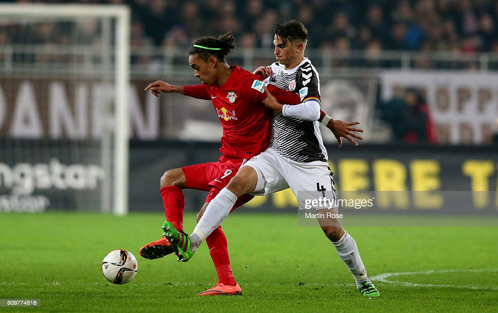 Philipp Ziereis (R) of St. Pauli challenges for the ball with Yussuf Poulsen of Leipzig during the second Bundesliga match between FC St. Pauli and RB Leipzig at Millerntor Stadium on February 12, 2016 in Hamburg, Germany.