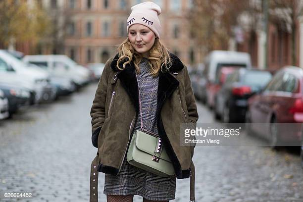 Philippa Sandberg wearing a pink HM wool hat a grey plaid checked Zara dress a khaki olive green Topshop jacket a green Valentino bag Calzedonia fish...