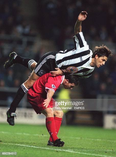 Philippe Albert Newcastle falls over the back of Robbie Fowler Liverpool
