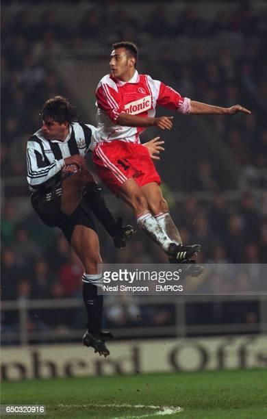 Philippe Albert Newcastle United {L} struggles in midair with Sylvain Legwinski AS Monaco {R}