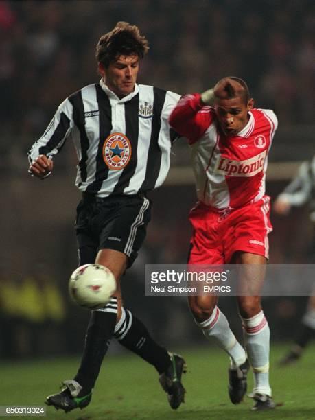 Philippe Albert Newcastle United {L} struggles to keep Anderson Da Silva AS Monaco {R} from the ball