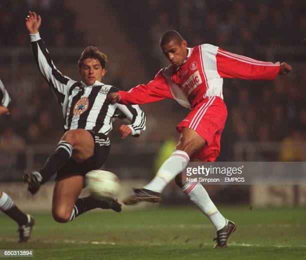 Philippe Albert Newcastle United {L} struggles to keep Anderson Da Silva AS Monaco {R} from shooting