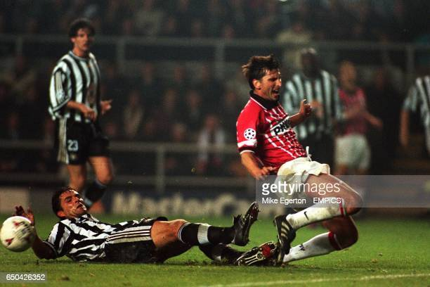 Philippe Albert of Newcastle United slides in to prevent Luc Nilis of PSV Eindhoven getting a shot in on goal