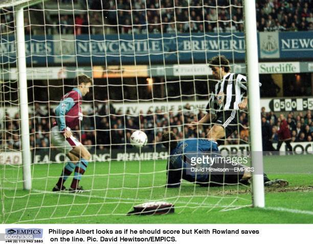 Philippe AlbertNewcastle looks as if he should score but Keith RowlandWest Ham saves on the line