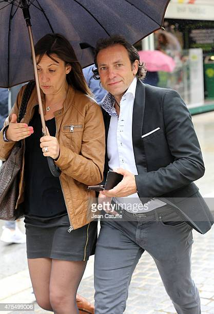 Philippe Candeloro and his wife Olivia Candeloro attend day 8 of the French Open 2015 at Roland Garros stadium on May 31 2015 in Paris France