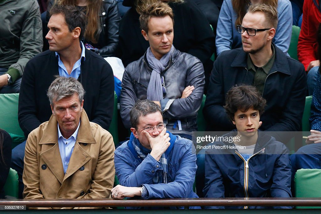 Philippe Caroit (L) and Frederic Bouraly attend the French Tennis Open Day 8 at Roland Garros on May 29, 2016 in Paris, France.