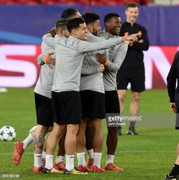Philippe Coutinho Alex OxladeChamberlain Roberto Firmino Alberto Moreno Adam Lallana and Georginio Wijnaldum of Liverpool during a training session...