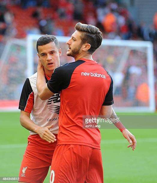 Philippe Coutinho and Adam Lallana of Liverpool warm up before the Barclays Premier League match between Liverpool and AFC Bournemouth on August 17...