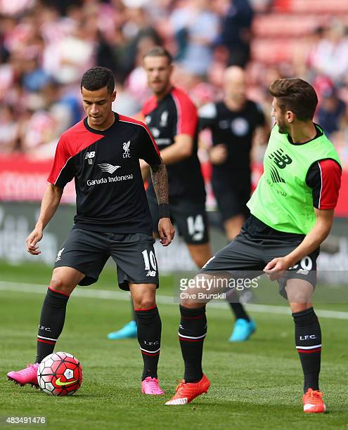 Philippe Coutinho and Adam Lallana of Liverpool warm up prior to the Barclays Premier League match between Stoke City and Liverpool at Brittania...