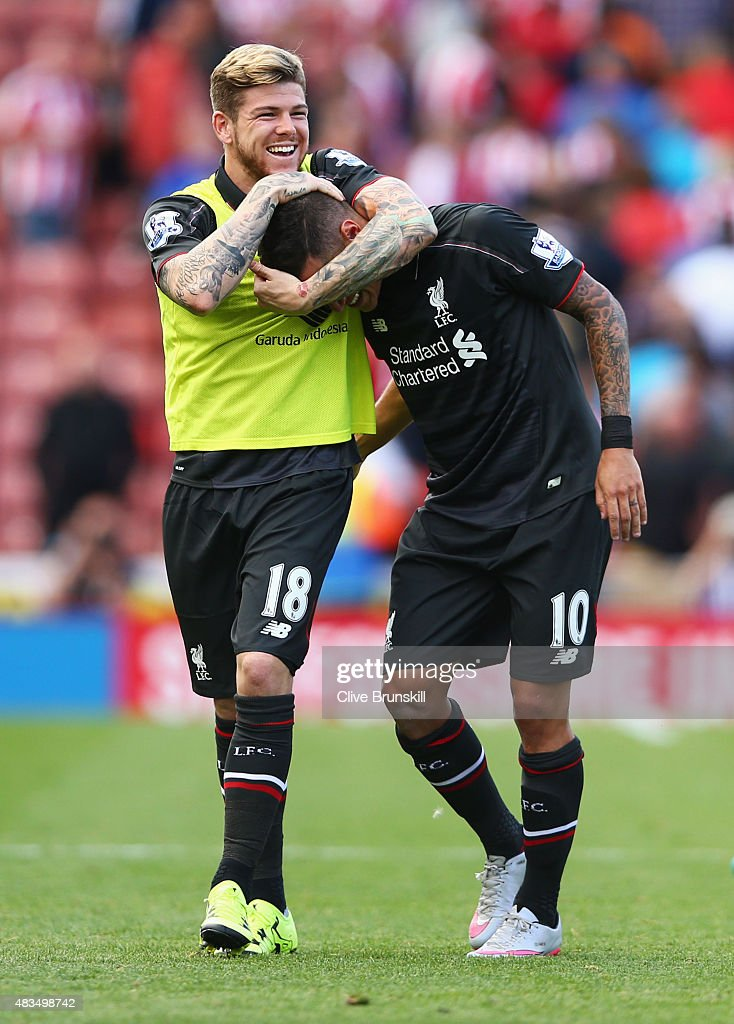 Philippe Coutinho and Alberto Moreno of Liverpool celebrate after the Barclays Premier League match between Stoke City and Liverpool at Brittania Stadium on August 9, 2015 in Stoke on Trent, England.