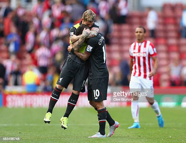Philippe Coutinho and Alberto Moreno of Liverpool celebrate after the Barclays Premier League match between Stoke City and Liverpool at Brittania...