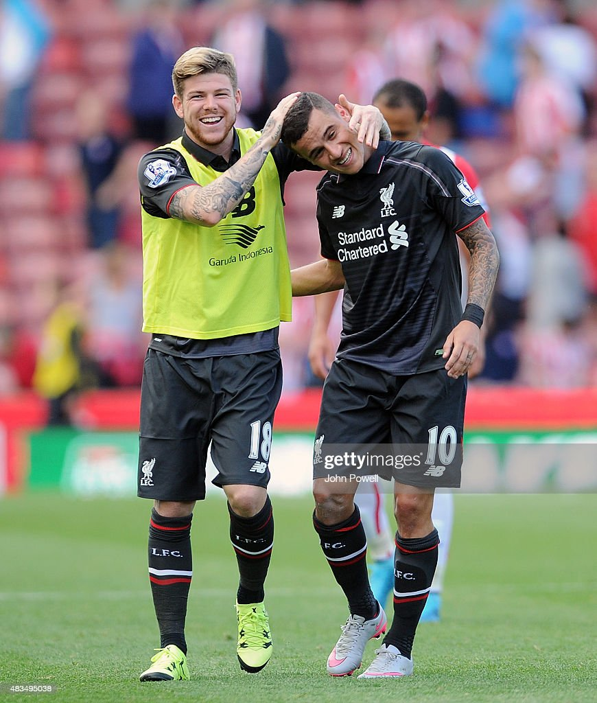 Philippe Coutinho and Alberto Moreno of Liverpool laugh with each other at the end of the Barclays Premier League match between Stoke City and Liverpool at Britannia Stadium on August 9, 2015 in Stoke on Trent, England.