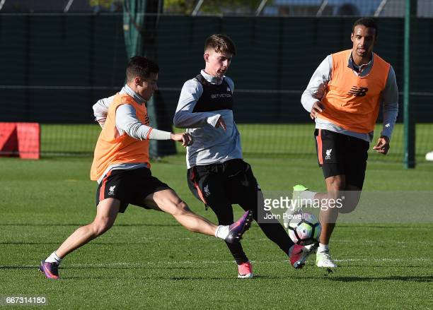 Philippe Coutinho and Ben Woodburn of Liverpool during a training session at Melwood Training Ground on April 11 2017 in Liverpool England