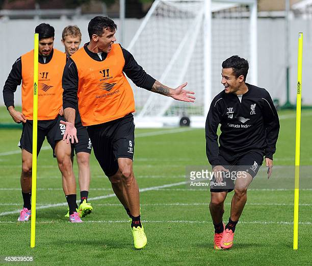 Philippe Coutinho and Dejan Lovren of Liverpool in action during a training session at Melwood Training Ground on August 15 2014 in Liverpool England