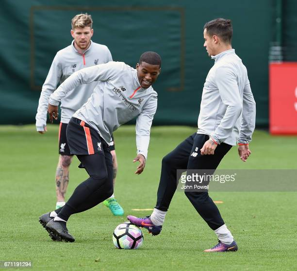 Philippe Coutinho and Georginio Wijnaldum of Liverpool during a training session at Melwood Training Ground on April 21 2017 in Liverpool England