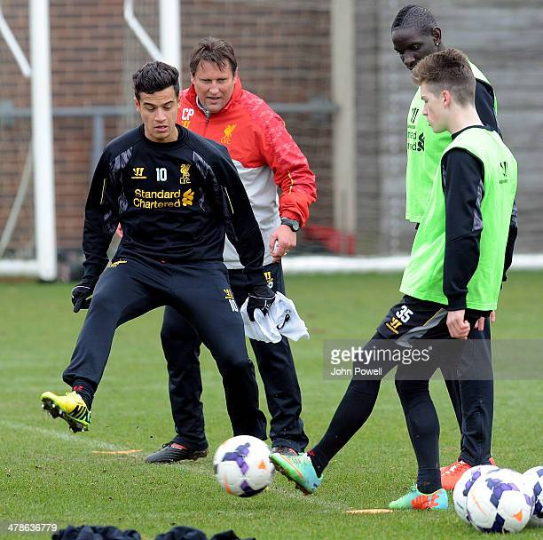 Philippe Coutinho and Harry Wilson of Liverpool in action during a training session at Melwood Training Ground on March 14 2014 in Liverpool England