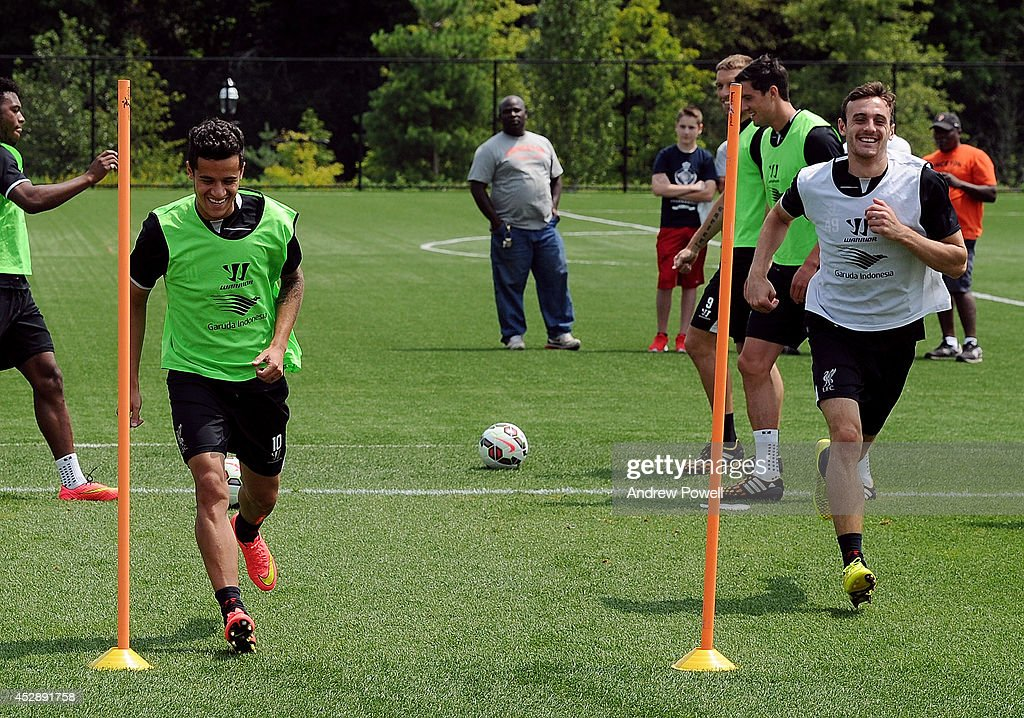 Philippe Coutinho and Jack Robinson of Liverpool in action during a training session at Princeton University on July 29, 2014 in Princeton, New Jersey.