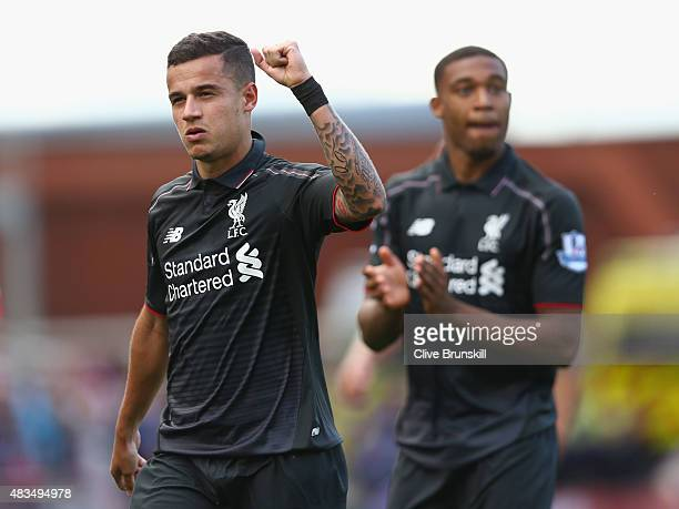 Philippe Coutinho and Jordon Ibe celebrate after the Barclays Premier League match between Stoke City and Liverpool at Brittania Stadium on August 9...