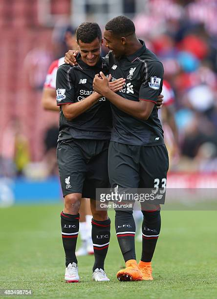 Philippe Coutinho and Jordon Ibe of Liverpool celebrate after the Barclays Premier League match between Stoke City and Liverpool at Brittania Stadium...