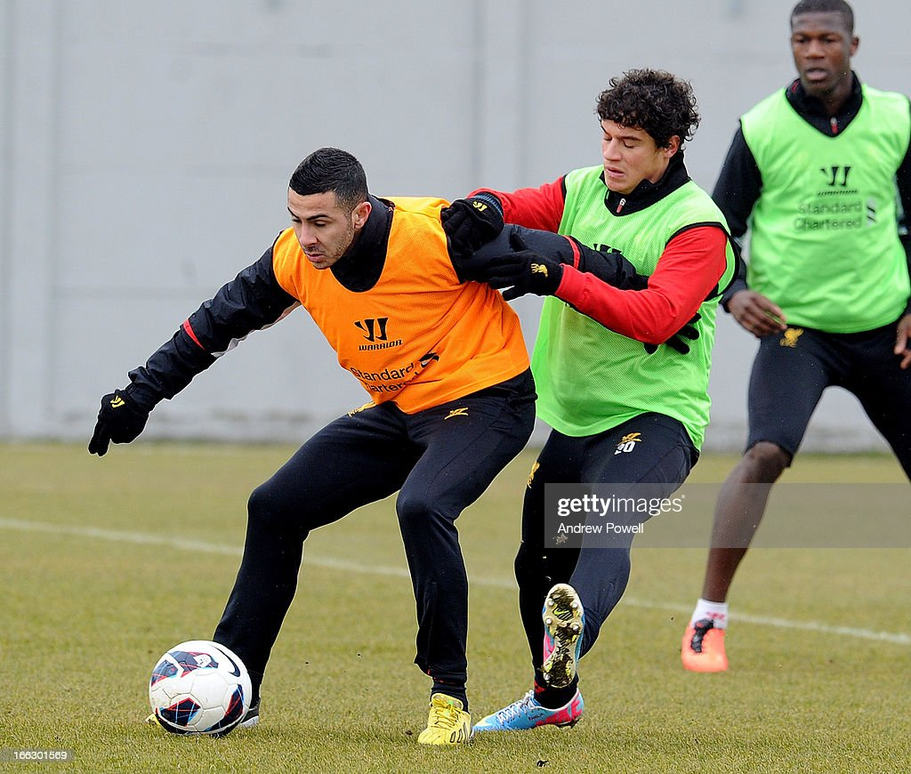 Philippe Coutinho and Oussama Assaidi of Liverpool in action during a training session at Melwood Training Ground on April 11, 2013 in Liverpool, England.