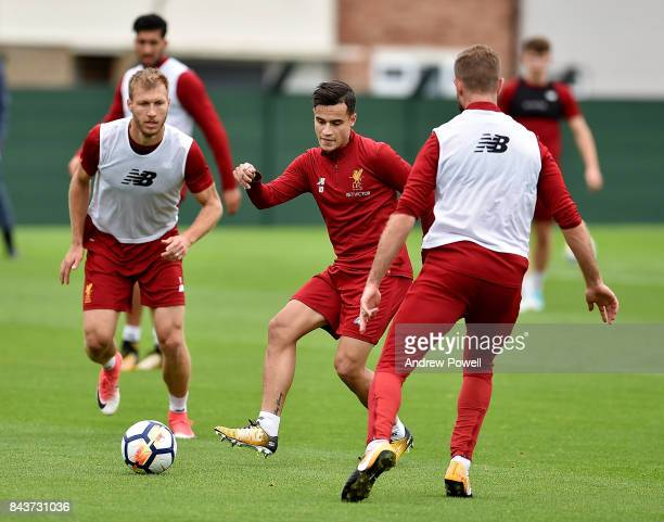 Philippe Coutinho and Ragnar Klavan of Liverpool during a training session at Melwood Training Ground on September 7 2017 in Liverpool England