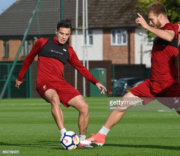 Philippe Coutinho and Ragnar Klavan of Liverpool during a training session at Melwood Training Ground on September 21 2017 in Liverpool United Kingdom