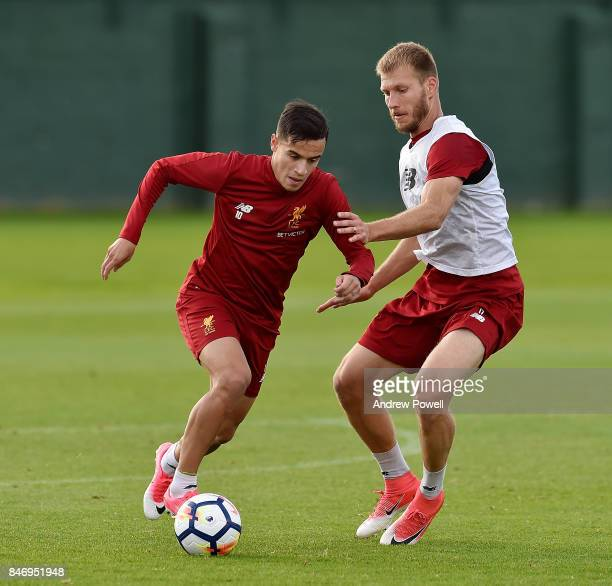 Philippe Coutinho and Ragnar Klavan of Liverpool during the UEFA Champions League group E match between Liverpool FC and Sevilla FC at Anfield on...