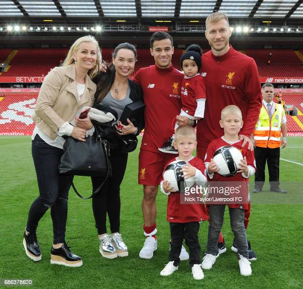 Philippe Coutinho and Ragnar Klavan of Liverpool with families celebrate at the end of the Premier League match between Liverpool and Middlesbrough...