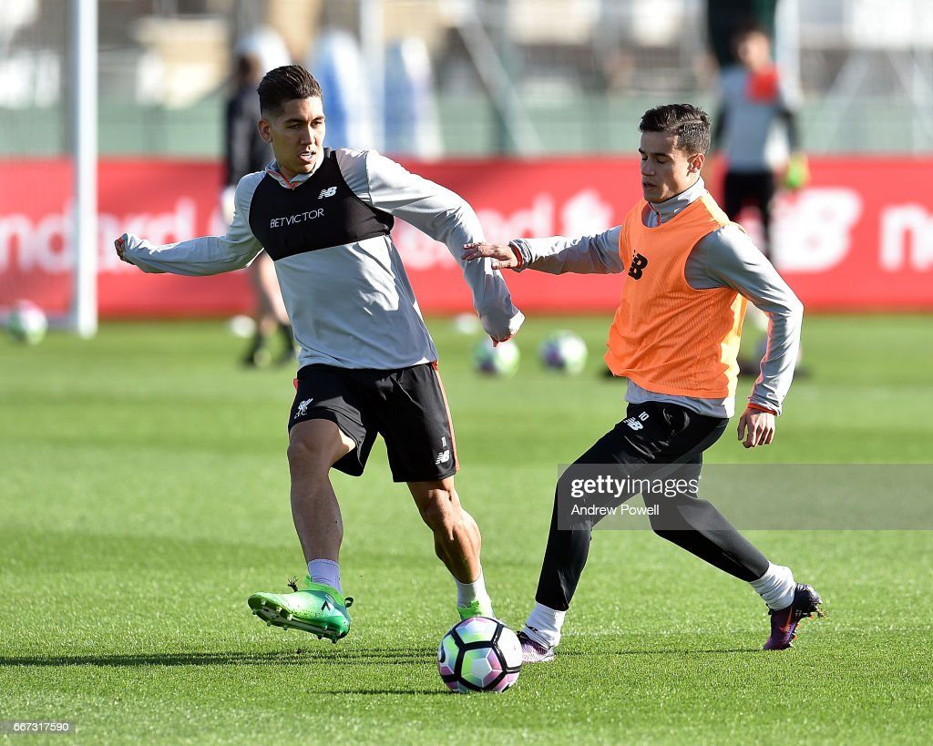 Philippe Coutinho and Roberto Firmino of Liverpool during a training session at Melwood Training Ground on April 11, 2017 in Liverpool, England.