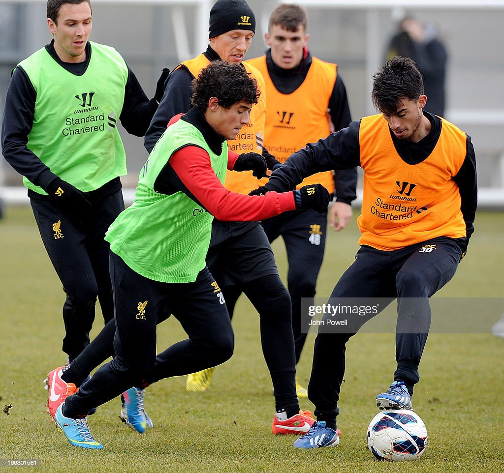 Philippe Coutinho and Suso of Liverpool in action during a training session at Melwood Training Ground on April 11, 2013 in Liverpool, England.