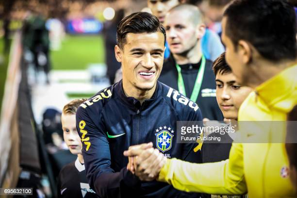 Philippe Coutinho greets Tim Cahill before Brazil plays Australia in the Chevrolet Brasil Global Tour 2017 on June 13 2017 in Melbourne Australia...