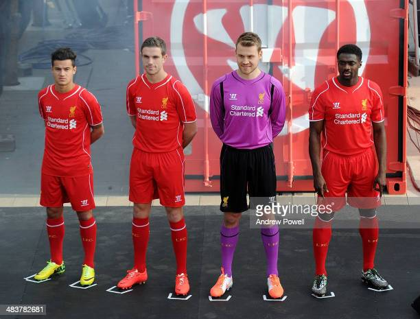 Philippe Coutinho Jordan Henderson Simon Mignolet and Kolo Toure of Liverpool present the new home kit for next season at Liverpool One on April 10...