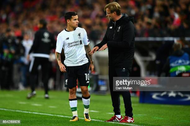 Philippe Coutinho o Liverpool speaks to Jurgen Klopp Manager of Liverpool during the UEFA Champions League group E match between Spartak Moskva and...